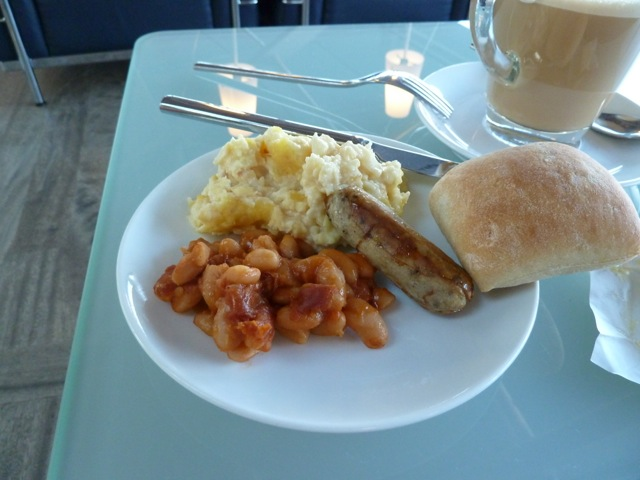 My breakfast: beans, scrambled egg and a veal sausage.