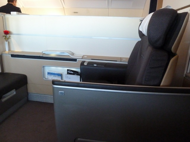 This picture was taken after take-off. The screen was raised by the crew to provide more privacy. Later on, the crew turned this seat into my bed, so I could lie down after the meal and wouldn't have to wait for them to make up the bed. The shell of the seat has further privacy screens that can be raised automatically.