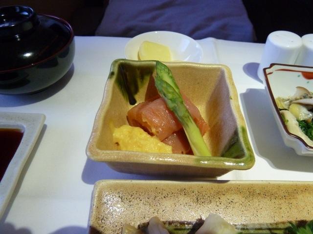 Smoked salmon with an egg vinaigrette and asparagus.