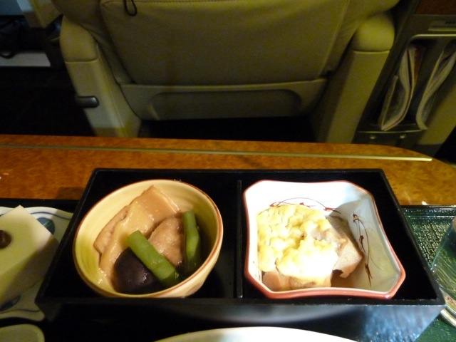 These two dishes are warm. The left one is duck, to other is a Japanese specialty. It's made with wheat.